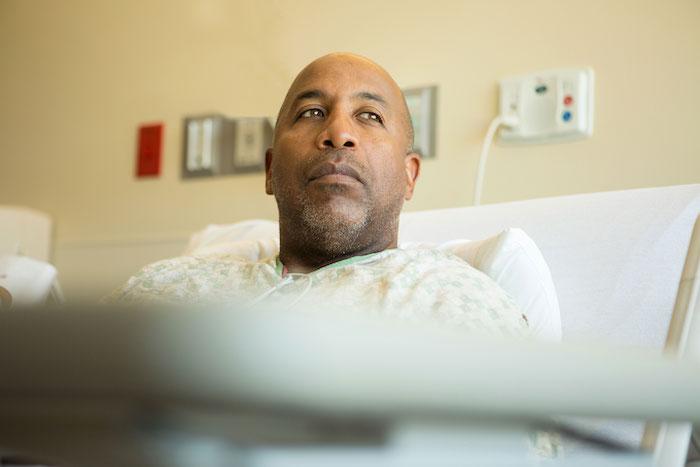 Older man in hospital bed