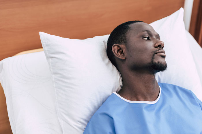 Male patient in hospital bed